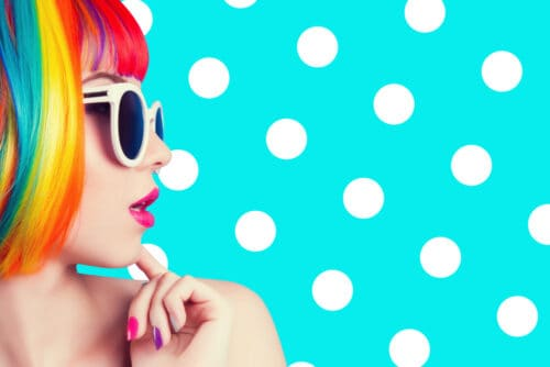 beautiful woman wearing colorful wig and white sunglasses against blue background angel numbers