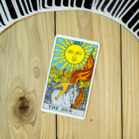 Deck of Tarot cards ; THE SUN .